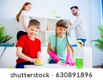 family cleaning house | Shutterstock . vector #630891896