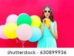 happy woman drinks a fruit... | Shutterstock . vector #630899936
