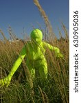 Small photo of ufo alien strange faceless creature on the field