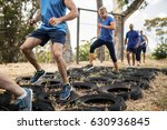 people receiving tire obstacle... | Shutterstock . vector #630936845
