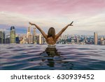 girl with her back in the pool... | Shutterstock . vector #630939452