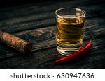 glass of tequila with cayenne... | Shutterstock . vector #630947636