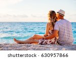 young couple in love sitting on ... | Shutterstock . vector #630957866