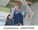 builder installing the rest of... | Shutterstock . vector #630979358