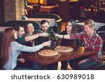 friends having a drinks in a... | Shutterstock . vector #630989018