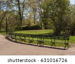 park benches curve around a... | Shutterstock . vector #631016726
