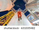 production engineer climb up to ... | Shutterstock . vector #631035482