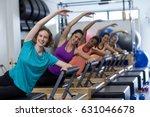 group of women exercising on... | Shutterstock . vector #631046678