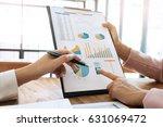 team work process. two women... | Shutterstock . vector #631069472
