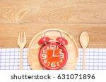 top view red alarm clock in... | Shutterstock . vector #631071896