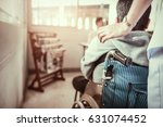 nurse pushing wheelchair  with... | Shutterstock . vector #631074452