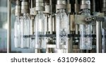 bottle filling with water | Shutterstock . vector #631096802