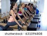 group of women exercising on... | Shutterstock . vector #631096808