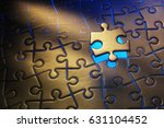 Small photo of Light glowing out from the spaces of an unfitted piece of a jigsaw puzzle