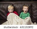 two scared little boys sitting... | Shutterstock . vector #631132892