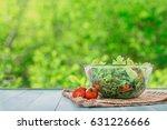 full bowl of fresh salad on a... | Shutterstock . vector #631226666
