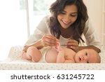 young mother moisturizing baby... | Shutterstock . vector #631245722