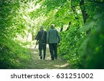two elderly persons  pensioners ... | Shutterstock . vector #631251002