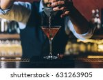 Stock photo expert barman is making cocktail at night club 631263905