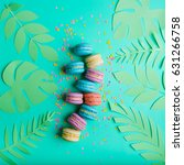 macaron dessert on a turquoise...   Shutterstock . vector #631266758
