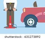 man pumps air car wheel | Shutterstock .eps vector #631273892