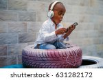 a bold boy listening to music... | Shutterstock . vector #631282172