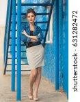 stylish pretty woman in striped ...   Shutterstock . vector #631282472