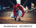 handsome young man man tying... | Shutterstock . vector #631304222