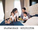 asian family spend time... | Shutterstock . vector #631311536