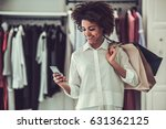 beautiful afro american girl is ... | Shutterstock . vector #631362125