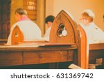 gothic church pews with priests ... | Shutterstock . vector #631369742