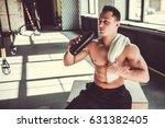 handsome young muscular... | Shutterstock . vector #631382405