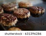 fat piece of beef meat frying... | Shutterstock . vector #631396286