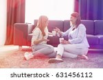 happy mother and daughter... | Shutterstock . vector #631456112