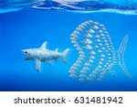 Small photo of Little fishes unite fight with big fish. a metaphor on teamwork