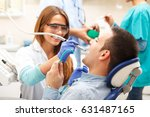 female dentists examining and... | Shutterstock . vector #631487165