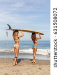 Two Sporty Surfing Girl With...