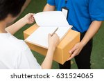 woman accepting a delivery of... | Shutterstock . vector #631524065