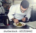 chef in restaurant garnishing... | Shutterstock . vector #631526462