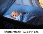 adorable baby drinking milk in... | Shutterstock . vector #631544126
