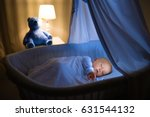 adorable baby drinking milk in... | Shutterstock . vector #631544132