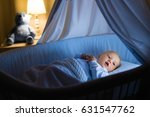 adorable baby drinking milk in...   Shutterstock . vector #631547762