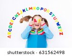 happy preschool child learning... | Shutterstock . vector #631562498