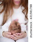 mother holding head of her... | Shutterstock . vector #631581788