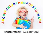 happy preschool child learning... | Shutterstock . vector #631584902