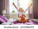 A Nice Child Girl Enjoys Sunny...