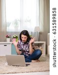 young woman with laptop in the... | Shutterstock . vector #631589858