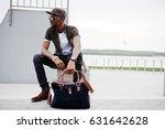 portrait of sitting stylish... | Shutterstock . vector #631642628
