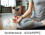 fit woman doing yoga on mat at... | Shutterstock . vector #631644992