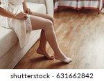 bride in silk robe putting on... | Shutterstock . vector #631662842
